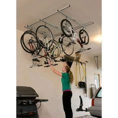 garage organization ideas bicycles | CycleGlide: Ceiling Mount Bike Rack | Garage Organization {ideas}