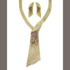 A multi-coloured sapphire and diamond cravatte necklace and pendent earclips (2) Estimate: £8,000 - 10,000 €9,100 - 11,000 US$ 12,000 - 16,000