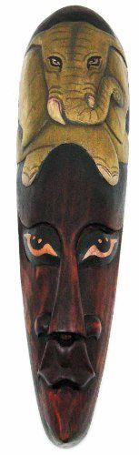 African Jungle Elephant Mask Wall Hanging Africa Decor by Private Label. $21.99. Made in Indonesia, this African mask wall hanging is hand-carved from dark Albesia wood. Measuring 19 inches tall, 5 inches wide and 2 inches deep, it looks great on walls in patios, outdoor tiki bars or any other jungle themed room. It features a hand-painted elephant on the top.This wall mask makes a great gift for friends and family. NOTE: Since these masks are hand carved and hand painted, ther...