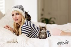 Emma Roberts is wearing a light pink boybrief with a striped top and knitted beanie.