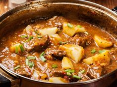 Made with onions, olive oil, lamb, bay leaves, tomato paste, water, paprika, red chile, potatoes | CDKitchen.com