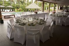 White Table Setting Tropical Wedding Reception Outdoors Outrigger Arrangement Elegant Fiji Outdoors Palms Nature Poolside Round Stunning Planner Tropical Wedding Reception, Fiji Beach, White Table Settings, Beach Resorts, Wedding Themes, Palms, Outdoors, Table Decorations, Elegant