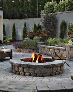 Belgard's Country Manor wood-burning fire pit allows for custom-made sizes and installations on existing structures.