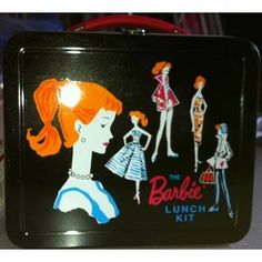 "I have this metal lunchbox, but in pink, bien sur!  I used it as a ""purse"" for a while, but the latch kept popping open.  Tres embarrassant."