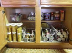 use freezer baskets to contain canned goods; easy to slide out basket to grab a can