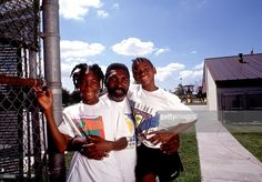 Richard Williams, center, with his daughters Venus, left, and Serena 1991 in Compton, CA. Serena and Venus Williams will be playing against each other for the first time July 6, 2000 in the tennis semifinals at Wimbledon.