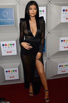 Kylie Jenner copies Kim in plunging black gown at Miami store opening #dailymail