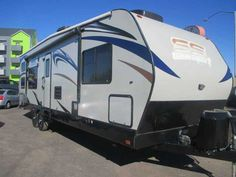 """2012 Used Pacific Coachworks Sandsport 280FS Toy Hauler in Arizona AZ.Recreational Vehicle, rv, 2012 Pacific Coachworks Sandsport 280FS, 2012 PACIFIC COACHWORKS SANDSTORM 280 FS TOY HAULER, 31' BOX, 34' OVERALL LENGTH, 145""""x88"""" of free floor parking plus 48""""x 55"""" in kitchen, queen walk around bed, 2 A/C UNITS, 5500 watt Oana/Cummins generator with ONLY 64hrs, power awning, power jack, double power rear bunks, sofa sleeper, 2 recliner chairs, lots of cabinets and storage, 3 burner stove with…"""