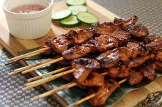 Pinoy Barbecue is a charcoal grilled sweet and savoury bite sized portions of pork in bamboo skewers usually served with hot and spicy vinegar. Filipino Bbq, Filipino Dishes, Filipino Recipes, Asian Recipes, Barbecue Recipes, Pork Recipes, Cooking Recipes, Yummy Recipes, Recipies