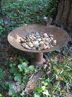 old satellite dish and other metal parts to make a bird bath and a little bird