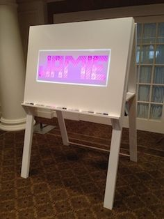 Light-Box Sign-In Board with easel by Surface Grooves LLC.  Custom built for your party!