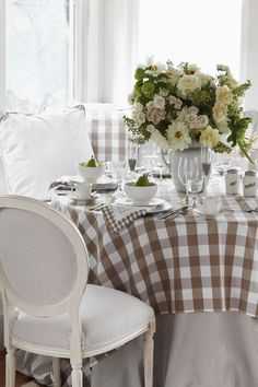 I love the floor length tablecloth with the subtle gingham overlay... so soothing