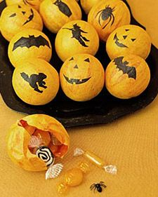 Paper mache treat balls for Halloween party favors.  Would be cute to make for other parties as well.