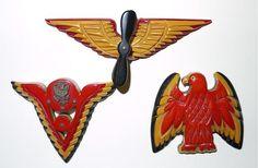 three cast carved Bakelite patriotic pins