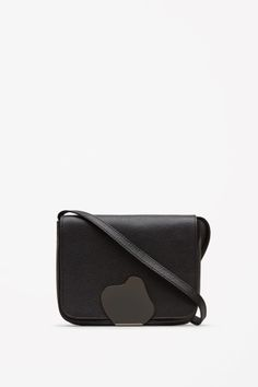 COS Metal clamp shoulder bag in Black