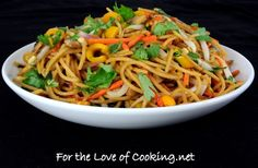 Vegetable Lo Mein:  8 oz Whole wheat spaghetti noodles, cooked per instructions 1/2 tsp sesame oil 2 tbsp hoisin sauce 1 tbsp soy sauce 1 tbsp canola oil (divided) 1 cup of mushrooms, sliced 1/2 cup of shredded carrots 1/2 cup of baby bell peppers, sliced 1/4 red onion, sliced 2 green onions, chopped 1/2 cup of mung-bean sprouts 1/2 tbsp fresh ginger, minced 3-4 cloves of garlic, minced 2 tbsp fresh cilantro, chopped (divided)