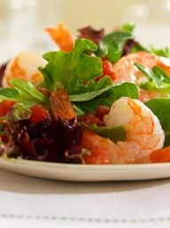 Try this fresh blend of arugula and salad greens tossed with a sweet tomato vinaigrette all topped with pan-seared shrimp.