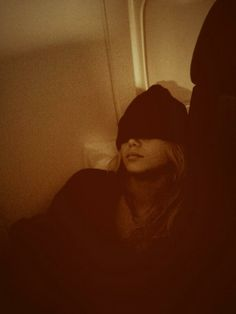 Olivia Holt sleeping on a plane December 2013