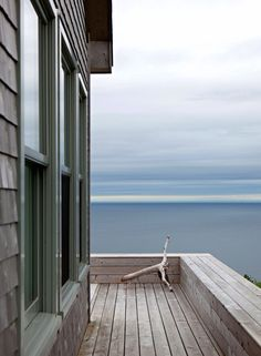 Simple storage bench blends with deck. Cottage in Cape Breton, Nova Scotia