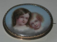 Victorian Porcelain Portrait Brooch Of Two Young Children Mounted In A 14k Gold Frame