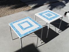 bought these cute little metal tables at a garage sale. put a new coat of paint and tiled the top.