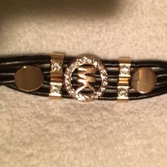 MK bracelet with stones/black leather Never worn and no stones are missing it's gold tone MICHAEL Michael Kors Jewelry Bracelets
