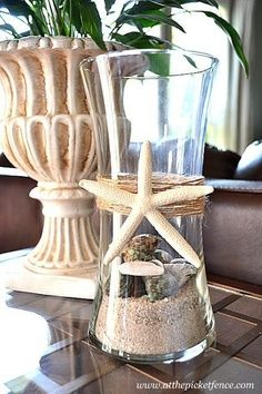 Outdoor hurricane vase with starfish, jute, sand and shells