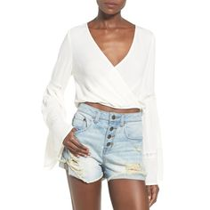 Junior Sun & Shadow Bell Sleeve Surplice Crop Top ($44) ❤ liked on Polyvore featuring tops, ivory vanilla, v neck long sleeve top, white surplice top, v neck crop top, white top and white v neck top