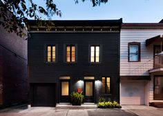 Architecture Open Form creates black facade for Montreal home