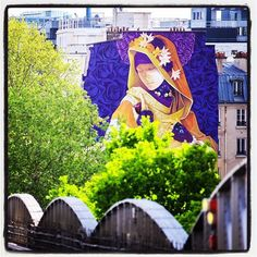 """Inti @ Paris... """"La Madre Secular 2""""  Photo : Lionel Belluteau Plus de photos sur https://ift.tt/YMhG58  La légende laissée par Inti : """"La Madre Secular 2"""" Paris France. Mural made for the project StreetArt13 """"La Madre Secular 2"""" its a lay representation of the Madonna where the sacred remains outside the religious context and stands as something possible without breaking the laws of nature.  Through the iconic composition with symbols linked to nature and science this Madonna replaces the…"""