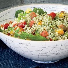 Israeli Couscous and Tomato Salad with Arugula Pesto | Arugula pesto is peppery and bright. The trick is to blanch the arugula and squeeze it dry, so when you blend it with the pine nuts, garlic, olive oil and cheese, the resulting pesto isn't too wet.