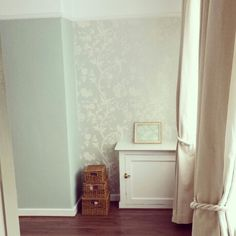 My living room painted in Laura Ashley eau de nil wall colour and wall papered in oriental garden.