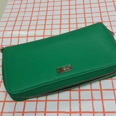 Thirty one jewel zip around wallet Green fairly new thirty one wallet in green. Very nice wallet with tons of space for storage. there is an id  slot with slots for 7 more cards along with a pocket for receipts and coupons, an area for dollar bills, zipper coin storage, six additional slots for more cards and another pocket for more papers or your phone! I do not have the wristlet strap but there is the availability to add one if u want Thirty one Bags Wallets