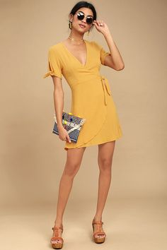 Lulus Exclusive! Make a statement all your own in the My Philosophy Golden Yellow Wrap Dress! Gauzy woven fabric sweeps across tying, short sleeves and a wrapping surplice bodice with hidden snaps and a tying waist. Lightly flared skirt falls to a flirty hem.