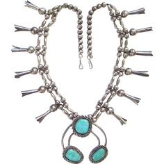 This is a Navajo Turquoise Squash Blossom Necklace Long Blossoms Sterling Silver Native American 24 Inch. The large naja has three gorgeous stones,