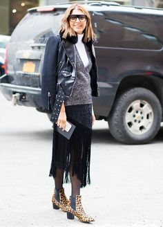 Style a moto jacket over a couple of sweaters, a fringed skirt, and a pair of tights with ankle boots.