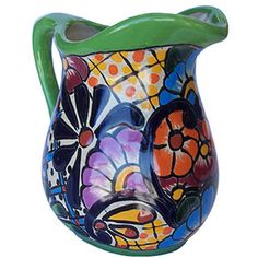 A Mediterranean talavera small pitcher belongs to our rustic home decor category. Its green and cobalt pattern painted over white background will add character to the living space. by Rustica House #myRustica