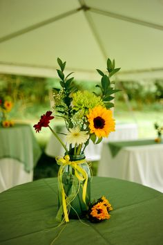 DIY wedding centerpieces - gerber daisies & sunflowers in mason jars
