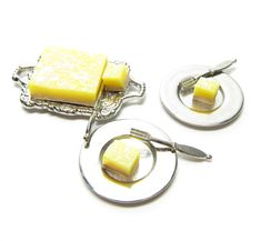These miniature lemon bars are made of polymer clay and feature a luscious layer of lemon on top of a shortbread crust. The top is sprinkled with powdered sugar for a bit of extra sweetness. They're p