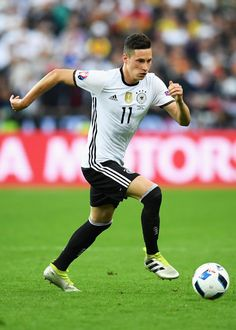 Julian Draxler of Germany in action during the UEFA EURO 2016 Group C match between Germany and Poland at Stade de France on June 16, 2016 in Paris, France.