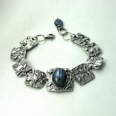 Bracelet made from silver (fine silver) with pretty bird motif. It is made with silver and beautiful, blue kyanit stone. The largest segment has and the smallest has Bracelet is long. Pretty Birds, Bracelet Making, Blue Bird, Silver Jewelry, Pearls, Sterling Silver, Stone, Crystals, Bracelets