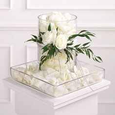 Get expert wedding planning advice and find the best ideas for wedding decorations, wedding flowers, wedding cakes, wedding songs, and more. Unique Wedding Centerpieces, Floating Candles Wedding, Flower Centerpieces, Reception Decorations, Table Centerpieces, Table Decorations, Centerpiece Ideas, Glass Cylinder Vases, White Centerpiece
