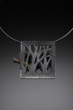 Raven the Observer - pendant by Joan Tenenbaum. Sterling Silver, 14kt gold, keum boo (fine gold and silver).