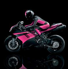 Carly Foulkes, model and rider from the T-Mobile commercial, with her matching Ducati 848 EVO and catsuit    from http://themotolady.com/tagged/tmobile