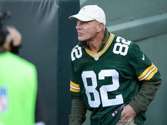Paul Coffman walks out of the tunnel as he is introduced at halftime. The Green Bay Packers welcomed their alumni back for their game against the New York Jets at Lambeau Field on Sunday, Sept. 14, 2014.