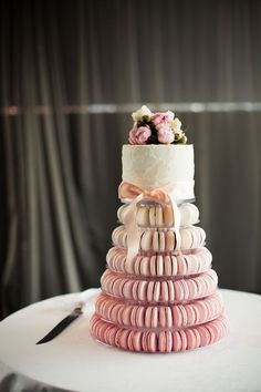 Stunning wedding macaron cake from a Sydney wedding. Even if you have a small gathering you can have a lavish looking cake.