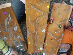 Marble run: scrap wood, nails, metal lids small cans