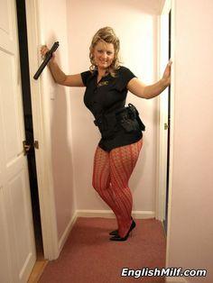 English milf Daniella in hot cop uniform and pink fishnet pantyhose.