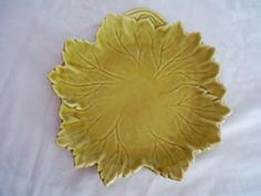Found four of these lovelies, saucer size.   Steubenville Woodfield Leaf Plates Golden Fawn.  You can feel the difference in quality just by picking one up and feeling the weight, and the delicate nature of the material.