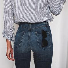 blue and white striped button down in high waist medium wash jeans. casual and simple style.